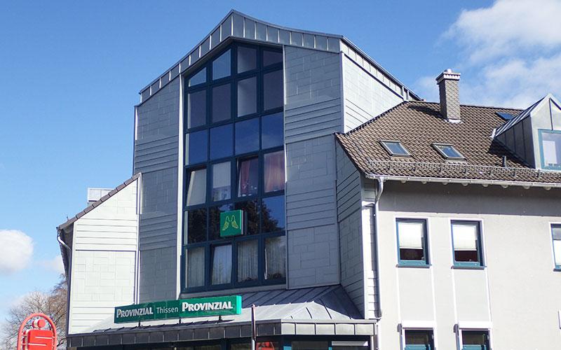 Fassadensanierung an einem Wohn- und Geschäftshaus